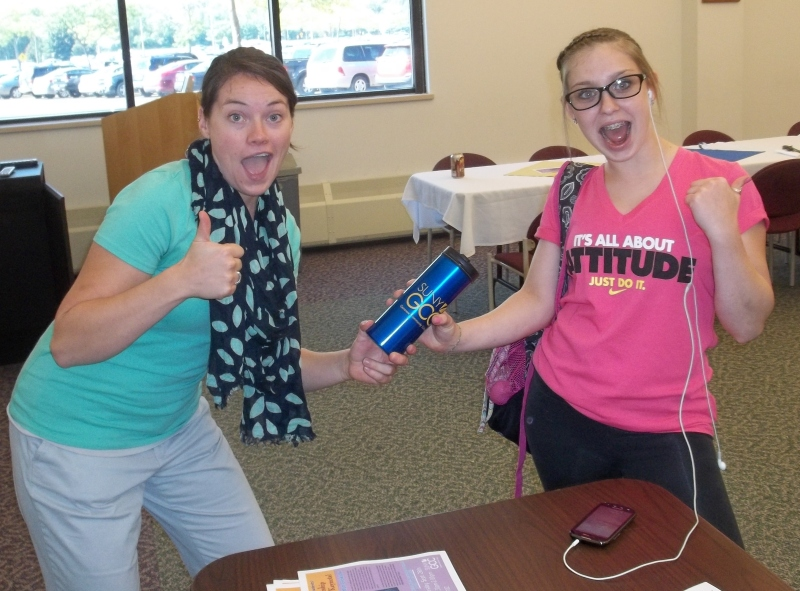 Sarah getting her free mug from Kristen Mruk.