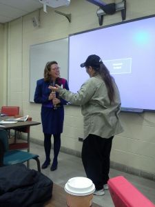 Ellen presenting a gift of appreciation to Donna Rae Sutherland