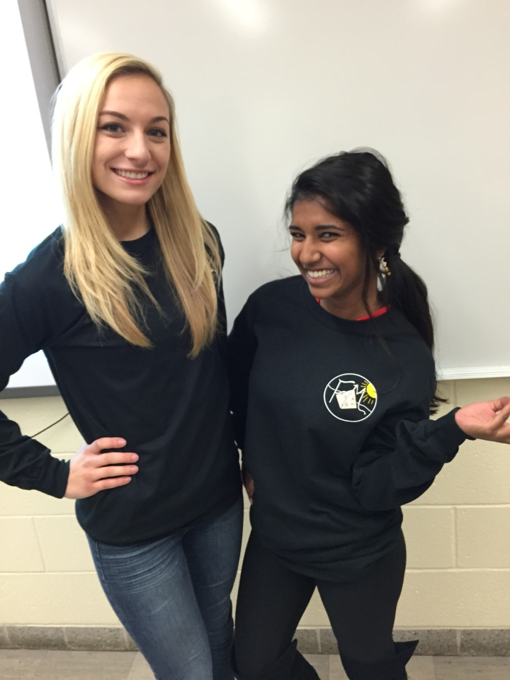 Fashion Design student Jocelyn Eade pictured with  her fabulous t-shirt design and Fashion Merchandising student Lekha Anderson.