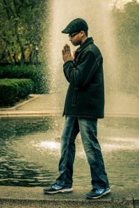 Bryan Grant posing on a fountain in Central Park, NYC.