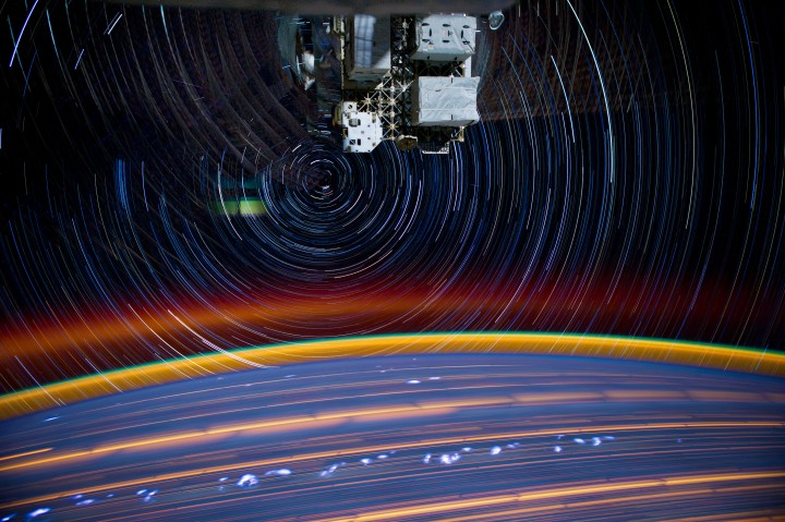 A Long shutter speed photo of stars and the Earth taken from the International Space Station. The round orb on the bottom is Earth. This photo was taken over time as the space station orbited our planet. Photo credit to NASA_JSC_Photo on Flickr.com