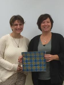 Giving Tanya our GCC plaid as a thank you for coming into class.